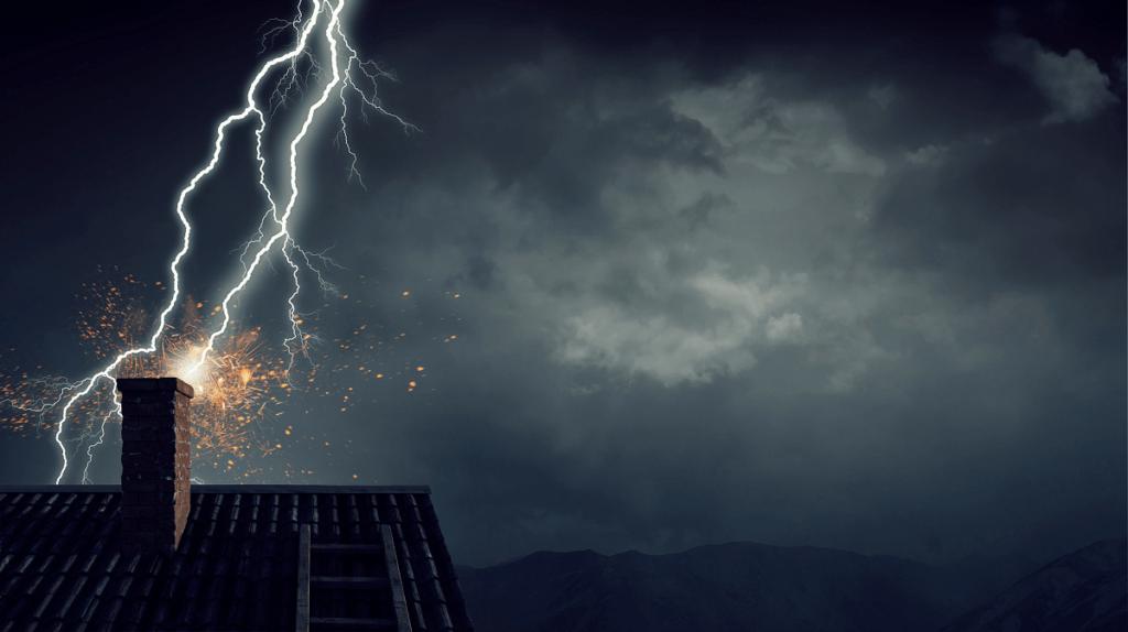 Lightning striking a chimney of a home