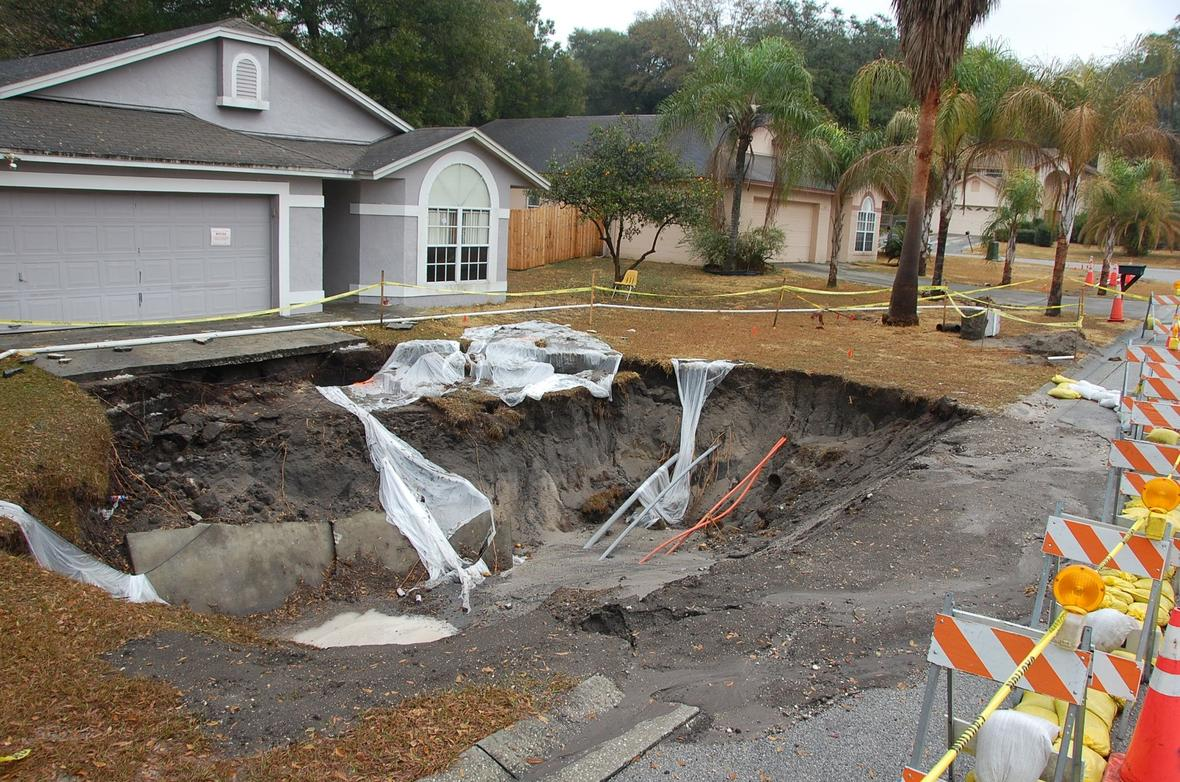 Sinkhole damage in family neighborhood.