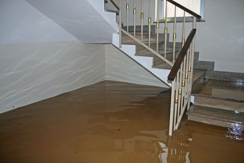water damage from flooding in home staircase