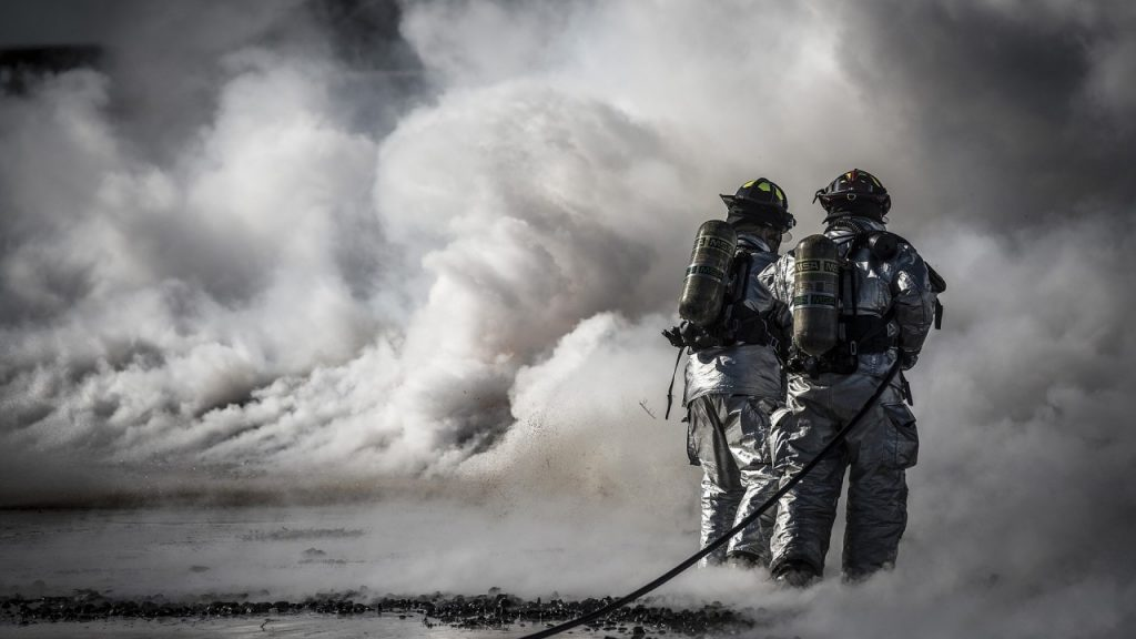 Fire fighters in a cloud of smoke